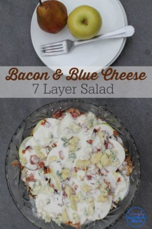 This delicious salad is made with fresh fruit, creamy blue cheese and bacon. It's great for grilling season and is a twist on a classic 7 Layer salad.